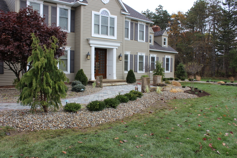 rock bed front yard trees landscaping job