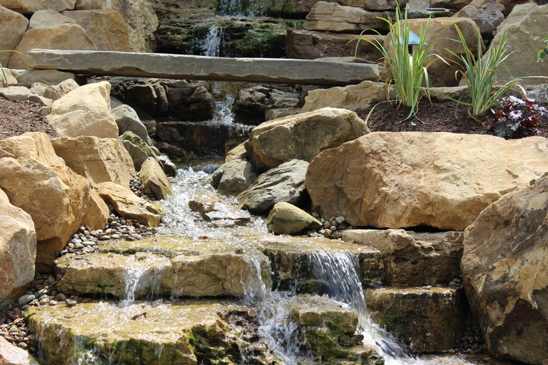 backyard garden waterfall installation lucas landscaping