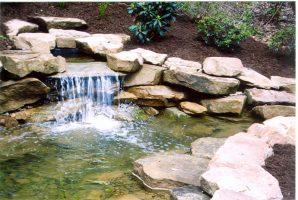 backyard pond installation lucas landscaping